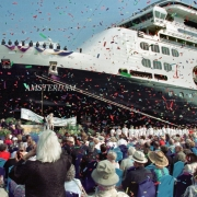 FORT LAUDERDALE Ñ Confetti flies as Holland America LineÕs newest ship, the $300 million ms Amsterdam, is dedicated at Port Everglades Monday, Oct. 30. Janet Lanterman, wife of Holland America Chairman and CEO Kirk Lanterman, served as the AmsterdamÕs godmother. The 1,380-passenger, 61,000-ton vessel is the 10th ship in Holland AmericaÕs fleet. On-board amenities include an all-suite deck with concierge services, the Web Site Internet cafŽ, the Odyssey gourmet Italian alternative restaurant, seven bars and lounges, a full casino and spa facilities. Following the ceremony Amsterdam set sail on a series of 10-day Panama Canal cruises from Fort Lauderdale. In April the ship is to reposition to Europe, and in January 2002 is slated to sail on a 100-day Grand World Voyage. Photo by Andy Newman/HAL