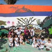Wland-with-kids-in-front-of-painting